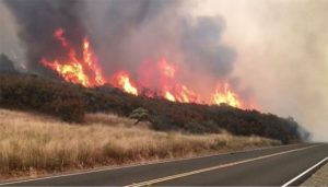At least 23 dead, hundreds missing as winds fan California wildfires.